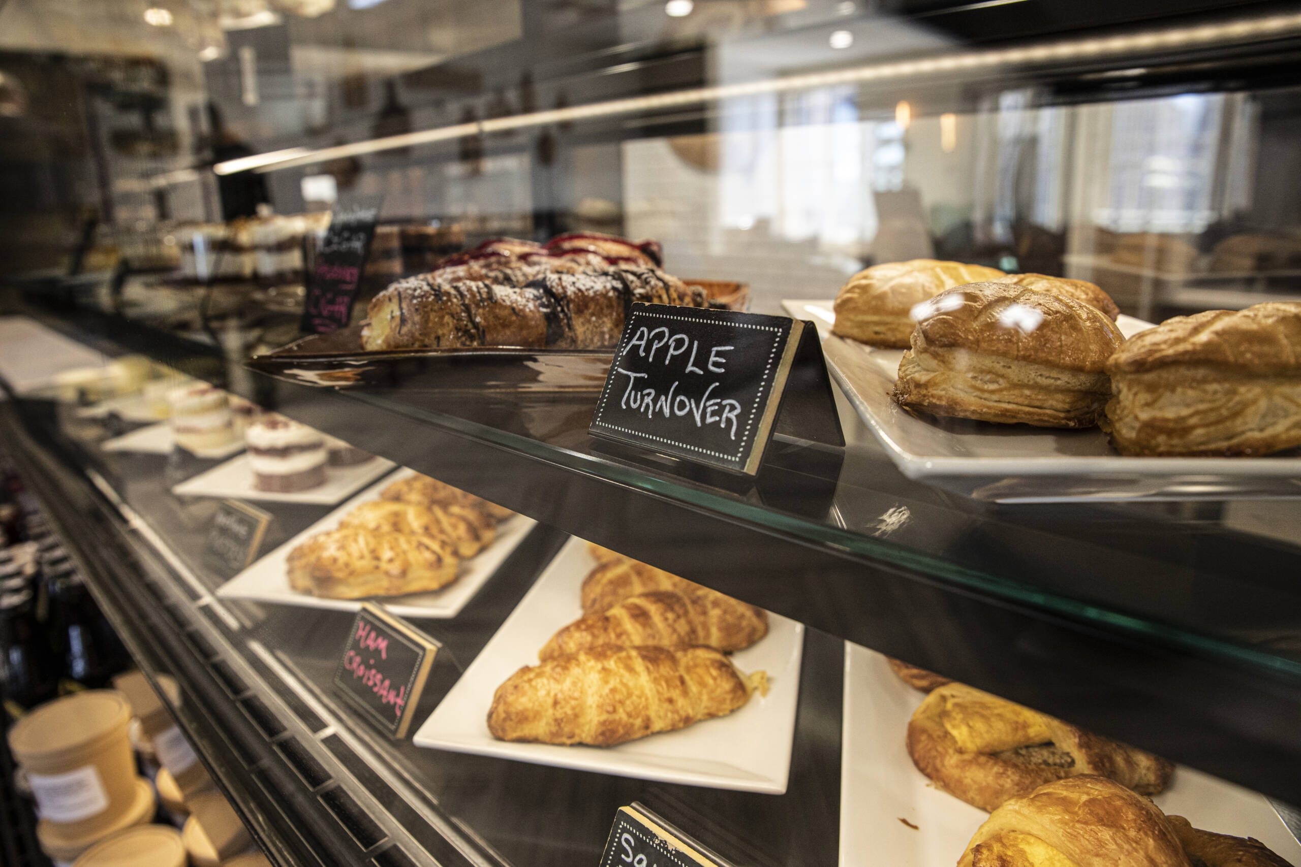 Pastry display with apple turnover sign